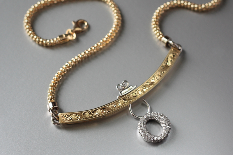 18k handmade, hand-engraved neckpiece with a round pave diamond dangling charm