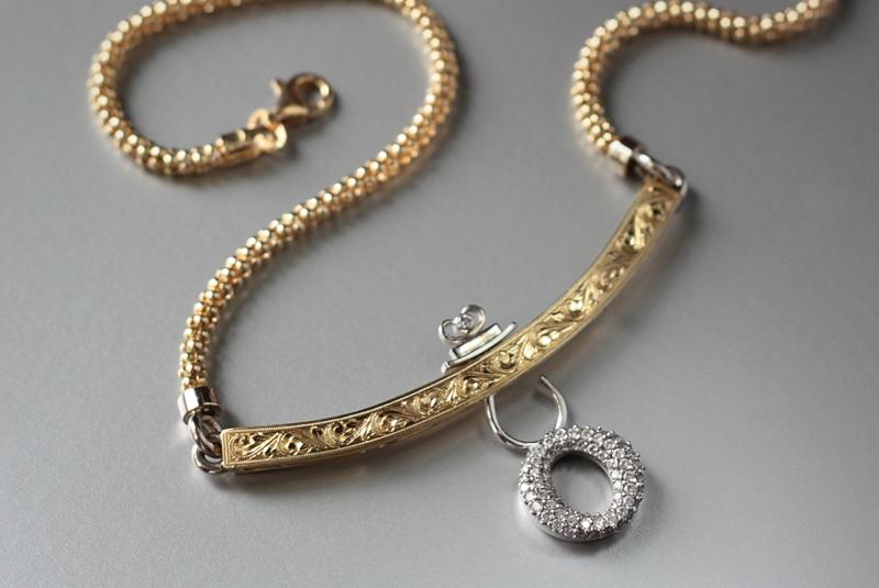 18k handmade, hand-engraved neckpiece with around pave diamond dangling charm