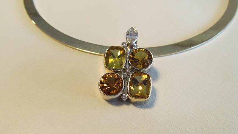 Combination white and yellow gold pendant bezel set with diamonds, topaz and citrine