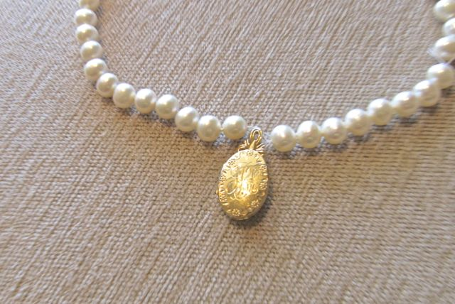 18k handmade and hand engraved hinged locket on pearl strand