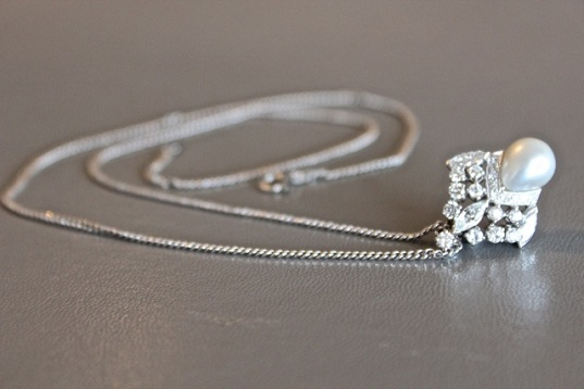 Platinum and diamond pendant that can also be worn as a ring