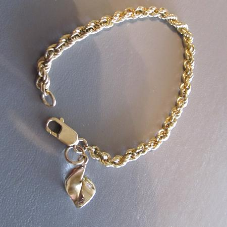 14k yellow gold rope bracelet and charm