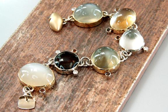 Moonbeam - 18k yellow gold bracelet with 6 bezel-set cabochon quartz in varied colors, 7- 5mm round-faceted savannah tourmaline and 5 diamonds (.80 ct. t.w., VS, G-H)