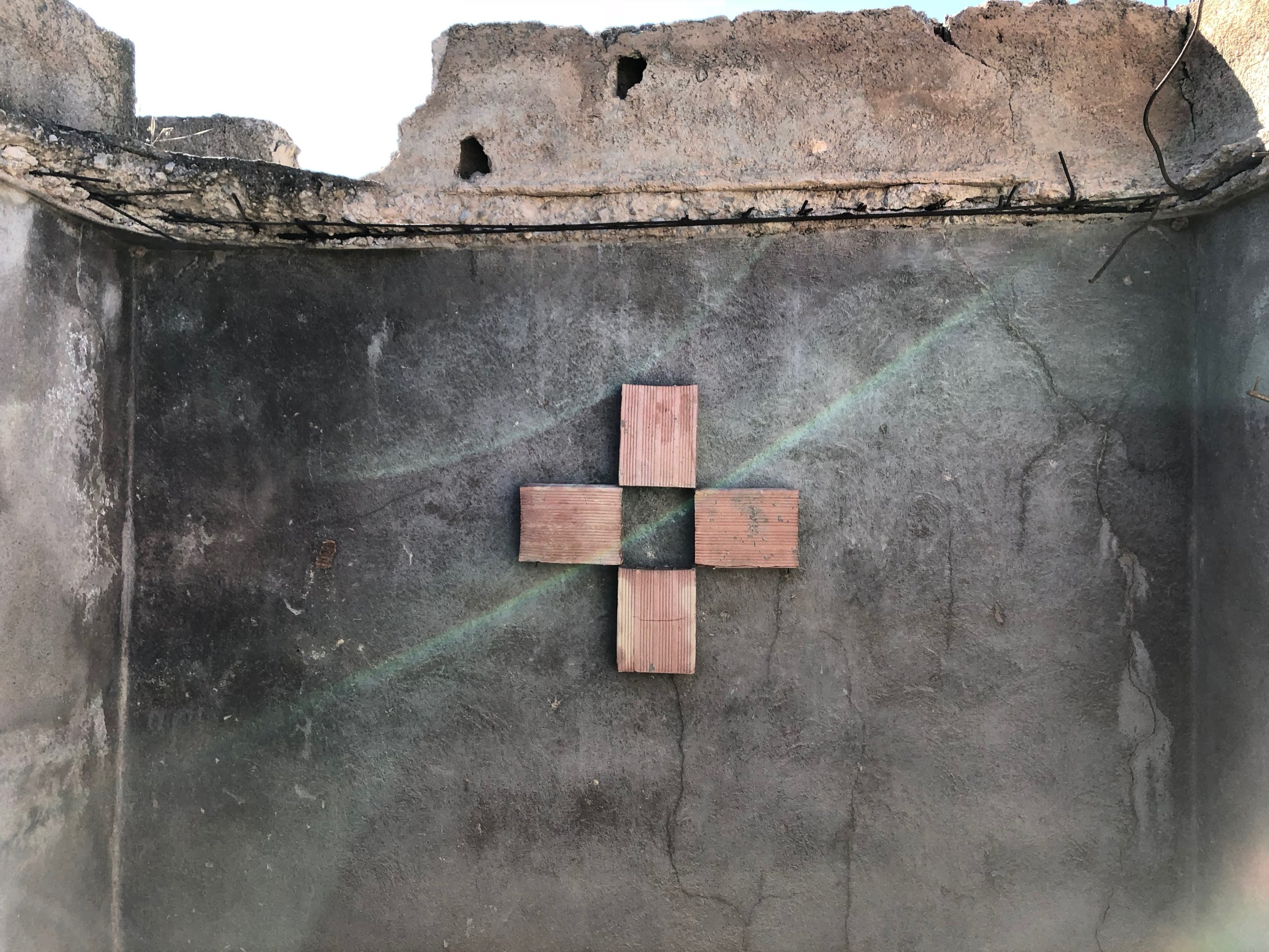 BIRD // CROSS  foundation bricks, nails.  2018 32 in x 32 in