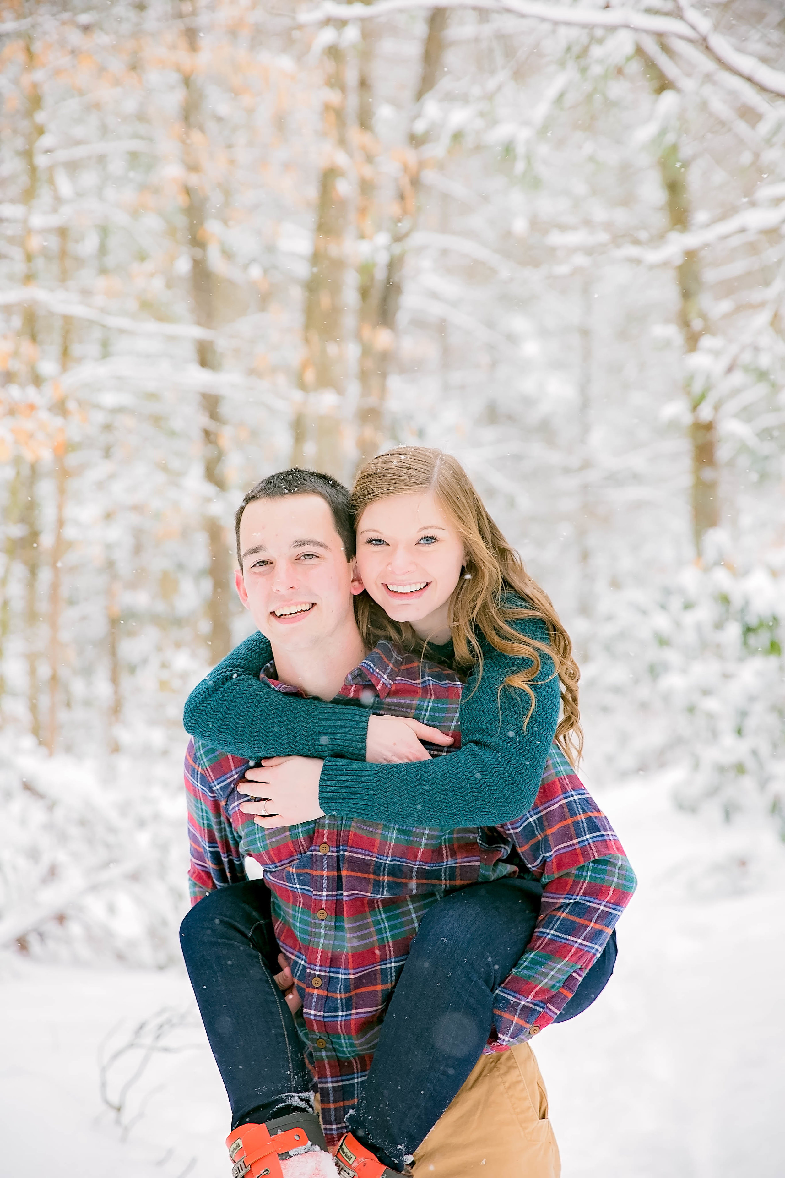 Playful snowy engagement