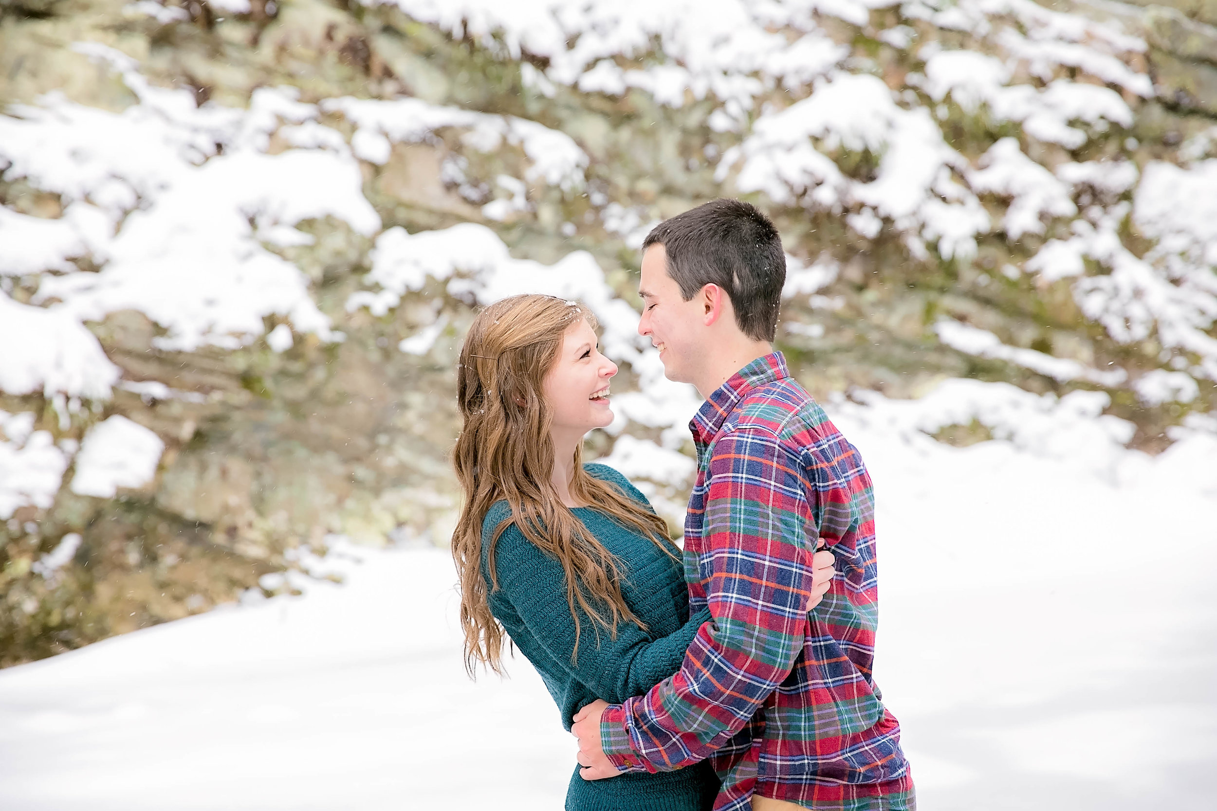 Couple laughing in snow
