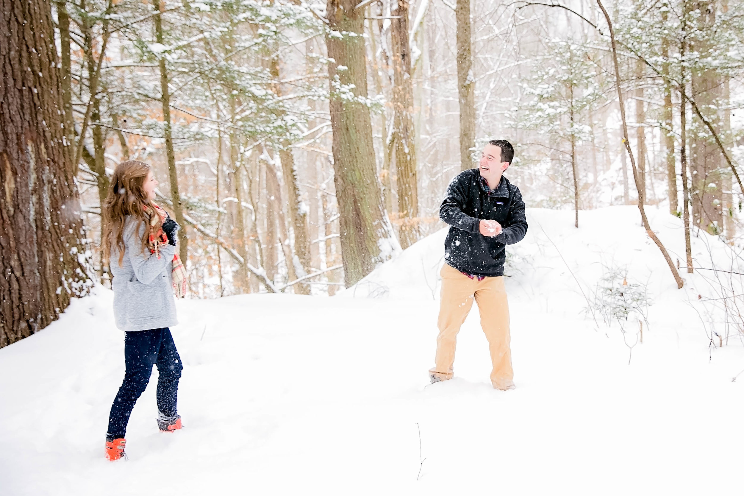 Snowball fight engagement session