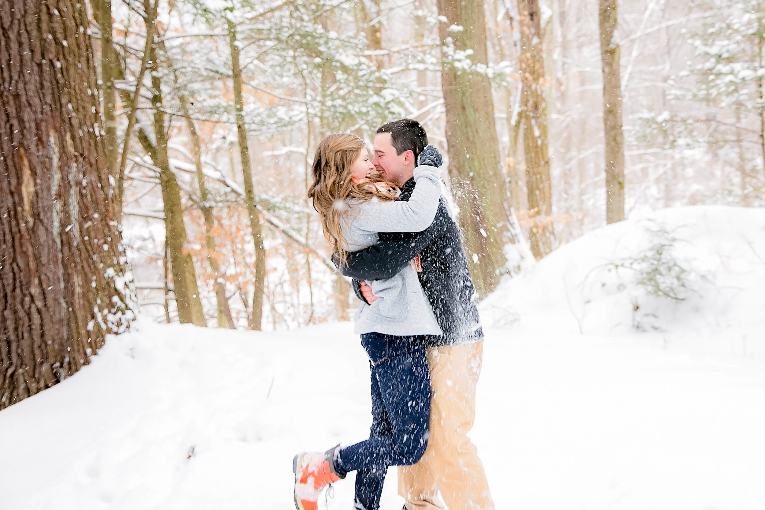 Couple playing in snow, Tennessee engagement