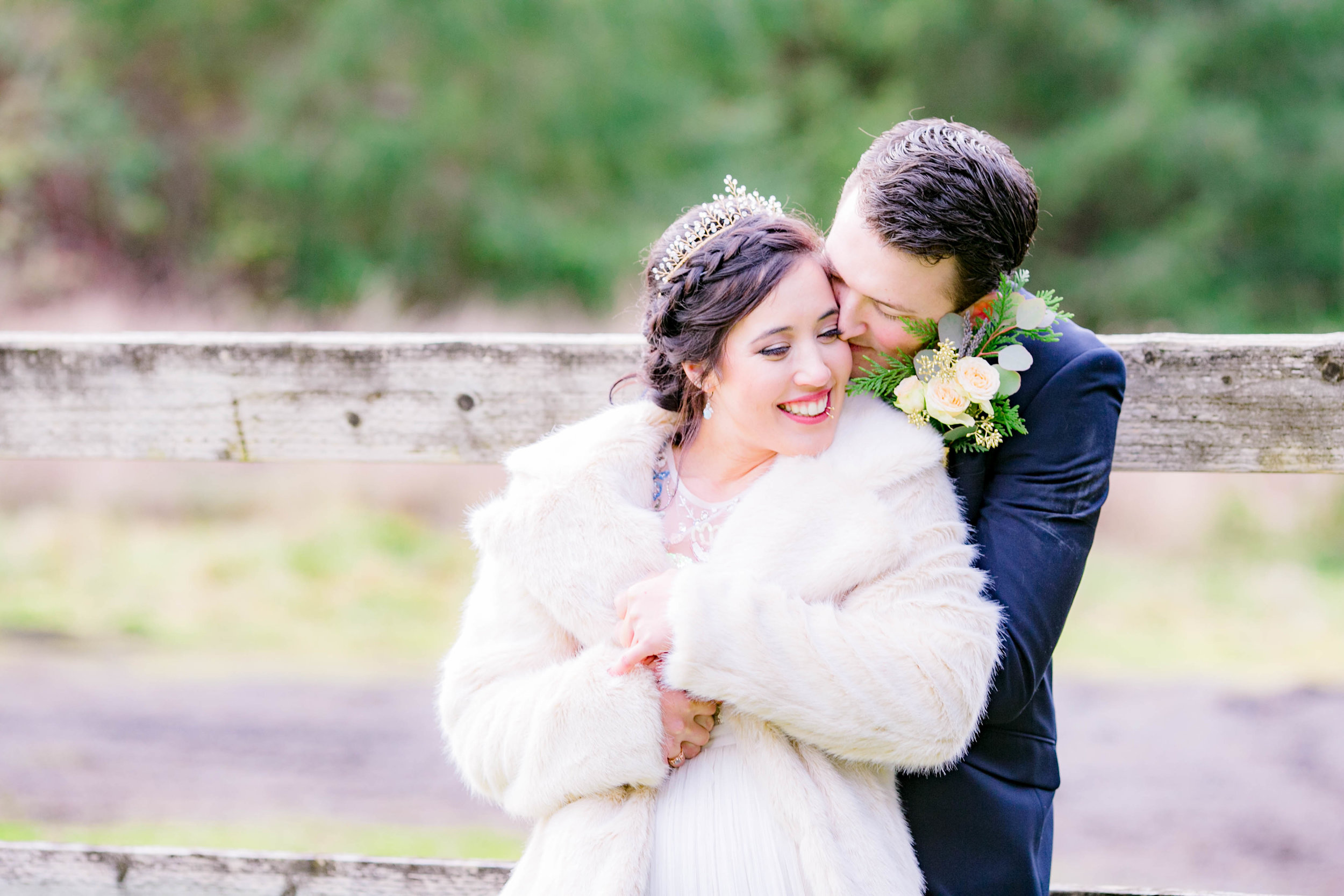 Bride and groom winter wedding portrait