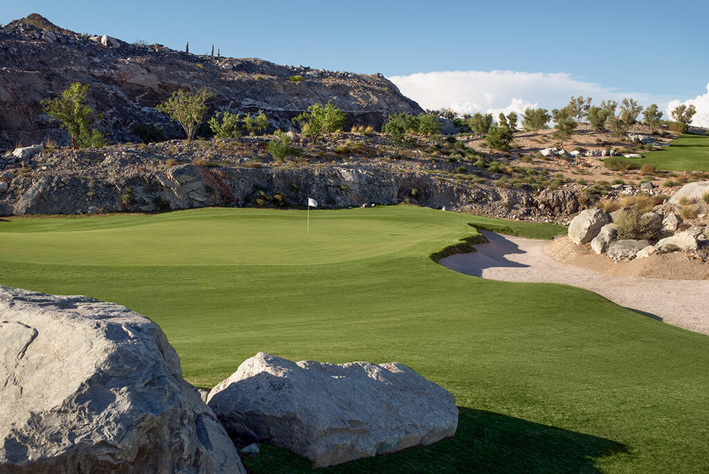 - We were able to bring in very large boulders that helped define the green complex and give a natural appearance and great back edge to the bunker right of the green.It was very important to us that this hole, which starts with a view of everything, ended up with a very secluded, intimate and rocky setting. We very much enjoyed the contrast between the two elements and are hopeful that everyone else appreciates it as well.The greens construction was a tremendous experience for us. Again, without the d9's, what we ended up with would have been difficult. The material that the green subgrade was built on could only be moved with a large dozer and just barely at that. We had to rip a few inches of material at a time and shove that material towards the tee.If you're on site a lot you have a chance to be there when opportunities arise. We were on site a lot. After pushing material and getting shapes that were manageable, a low developed on the front right that was there due to pushing material to the left. It was the first solid idea for finishing the green. We had a large rock outcropping that we hit on the front left, we kept it large like it was. We had a large roll off to the left that we loved and after some time we finally had a green that was pinnable and interesting.It took a lot of effort by many but the 18th green is something we are very proud of and something we thoroughly enjoyed creating. A big thanks to DMB for allowing us the opportunity.