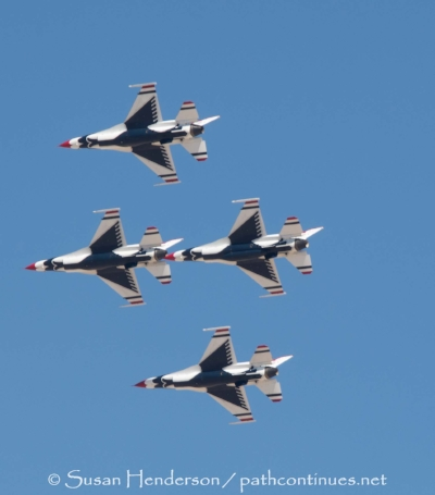 """Cresting a hill in Southern NV we saw smoke off in the distance. As we got closer we realized that it wasn't smoke but the """"Thunderbirds"""" practicing outside Nellis Air Force Base. We pulled over and had a private air show."""