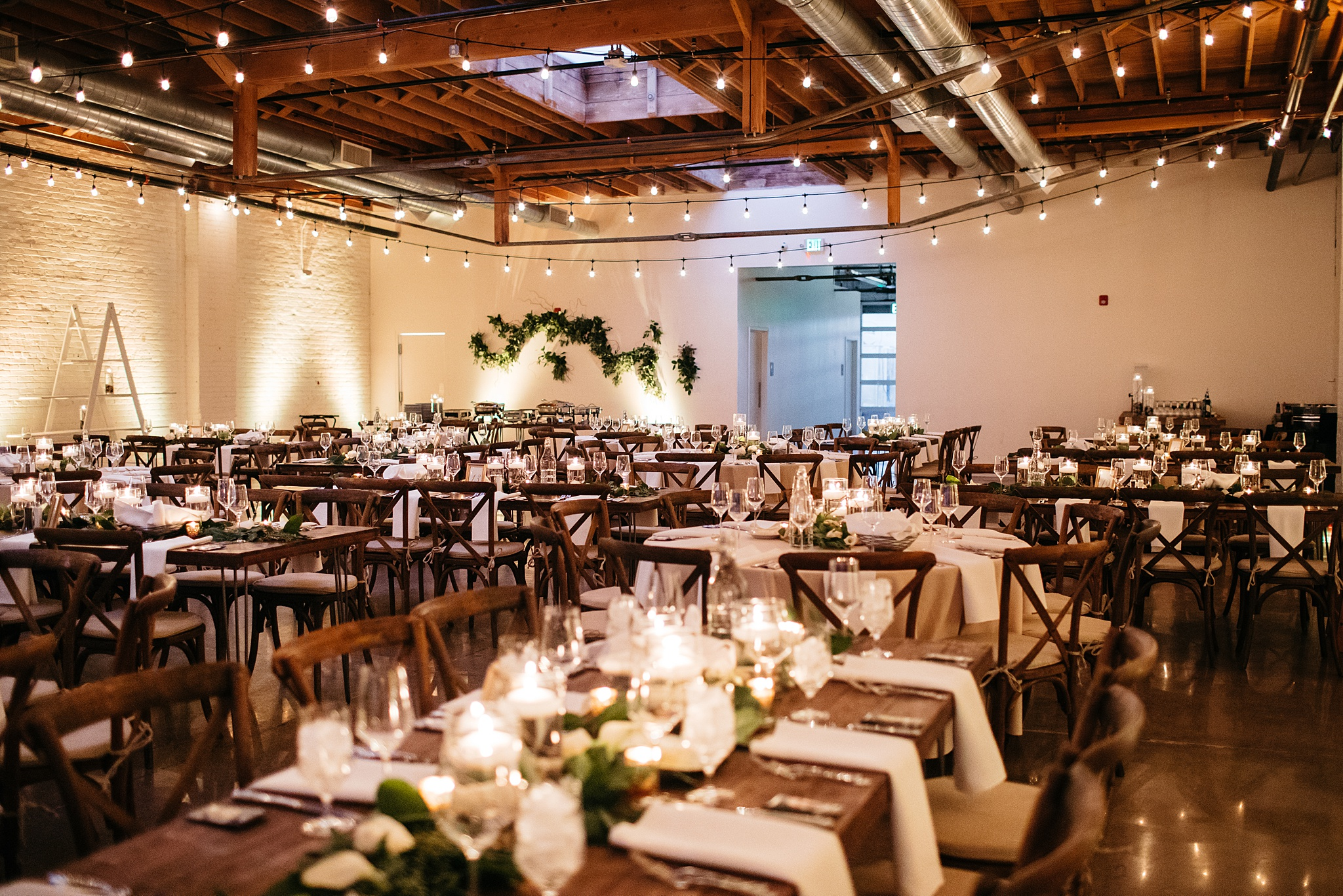 A photo of Skylight all set up with greenery and candles for a NYE wedding last year.