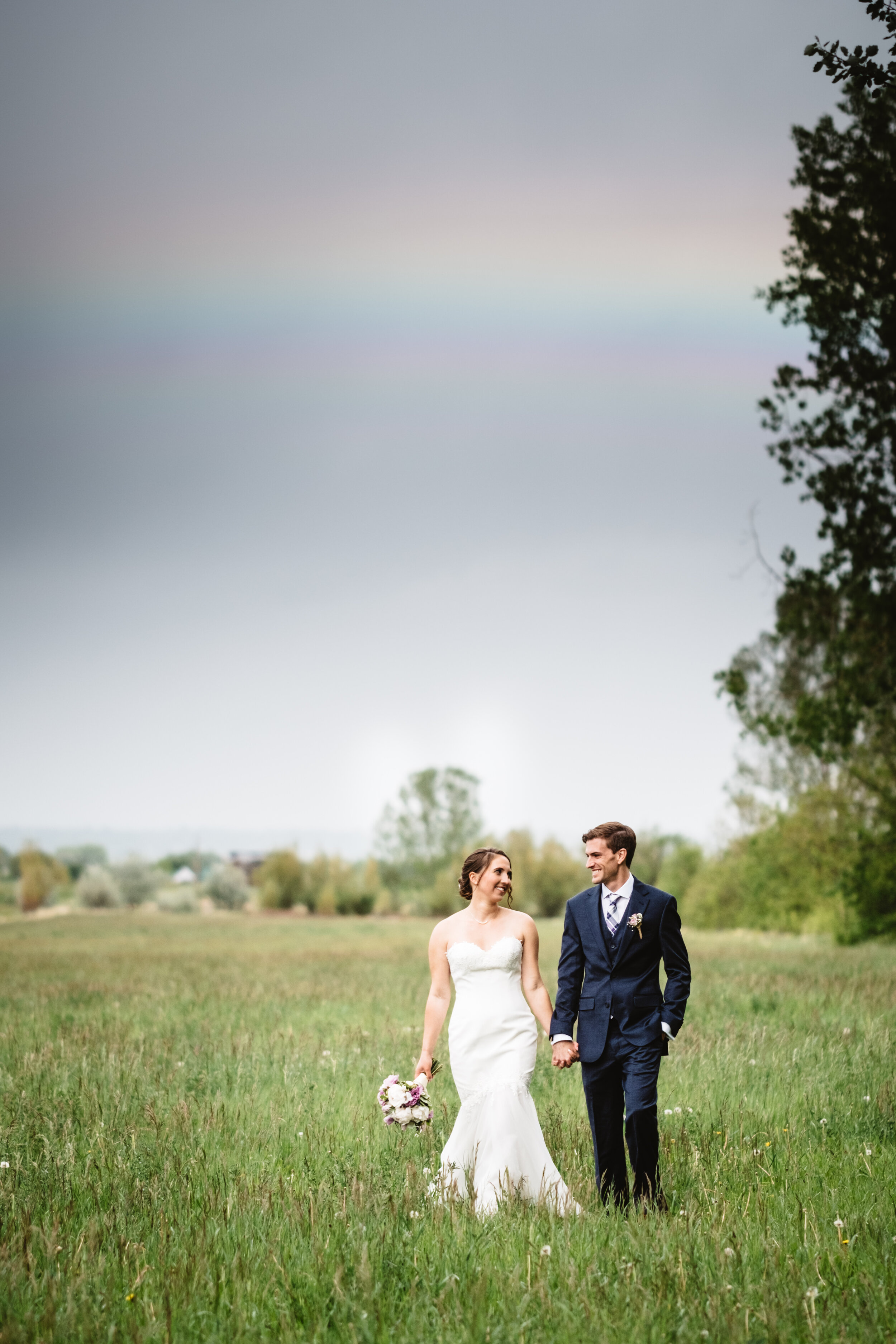 Chelsie + Mike got so lucky with this rainbow over the grounds of Lone Hawk Farm right after their ceremony. This is one of the pasture areas at the farm which is just gorgeous for photos!