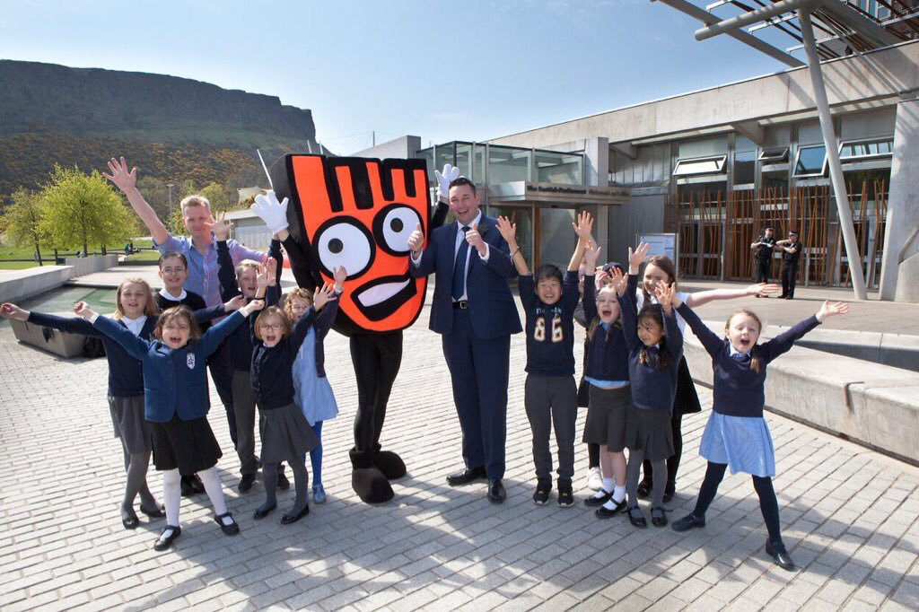 Miles with pupils from Abbeyhill Primary School promoting safe journeys to school.