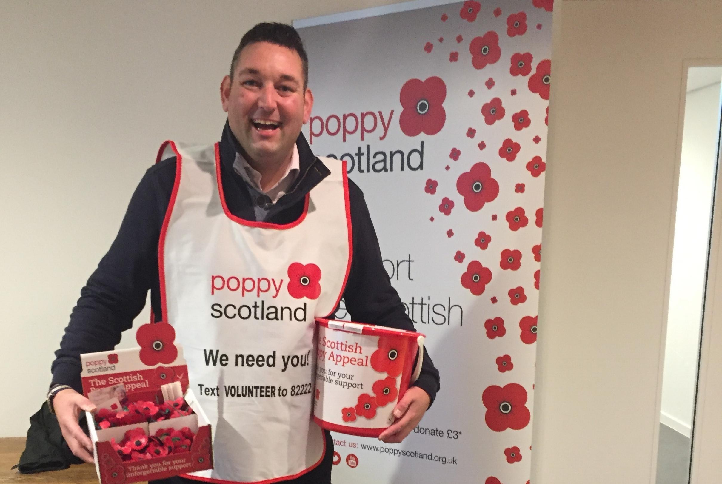 Miles collecting money for Poppy Scotland
