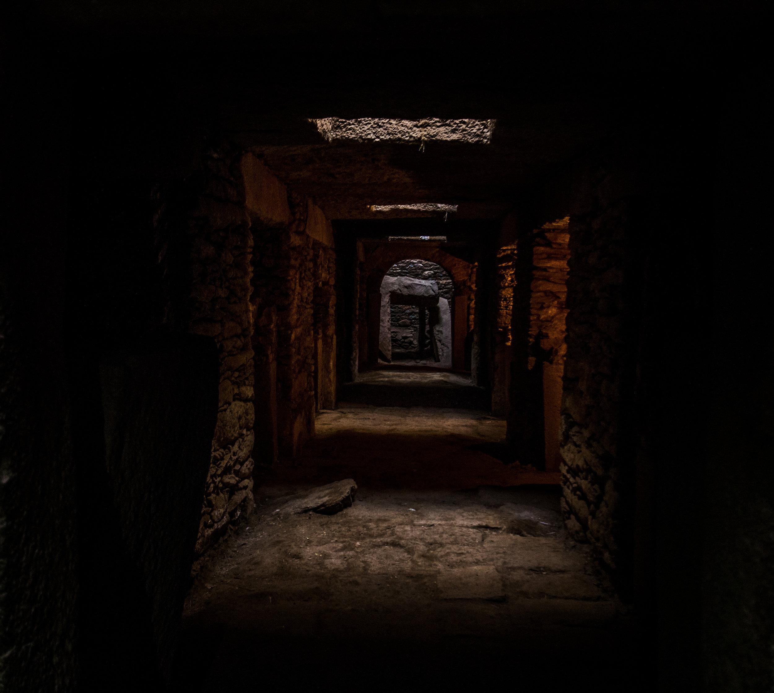 Tombs beneath the stelae.