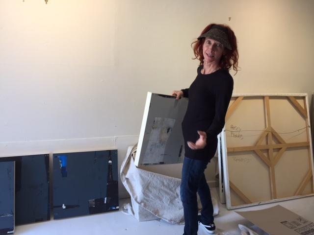 Peggy Ferris unwraps her work.