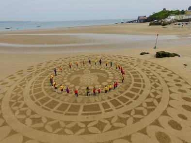 Sand mural by Marc Treanor.   Click here   to see more.