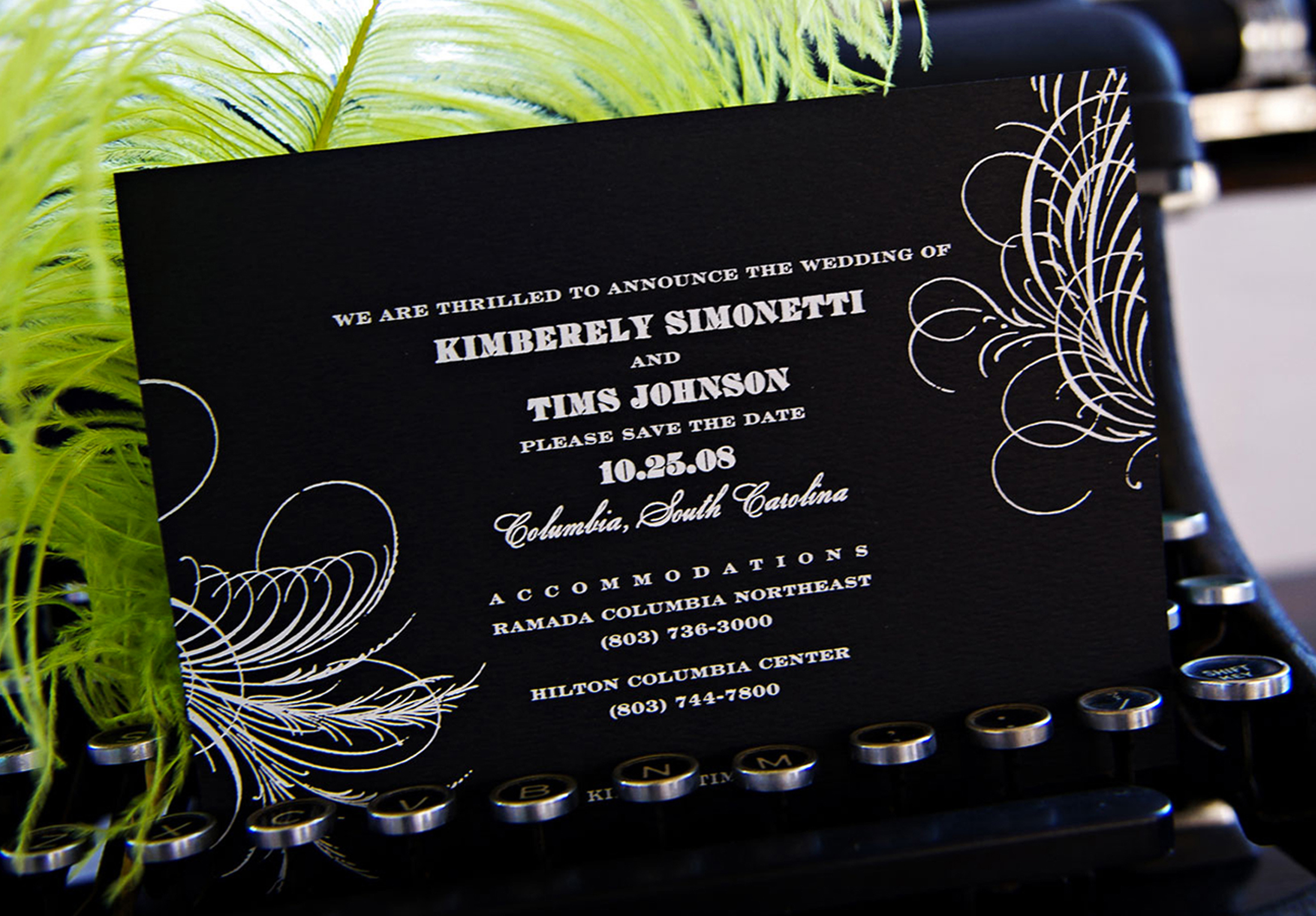 Foil pressed save the date. Matte white foil on black felt weave paper.