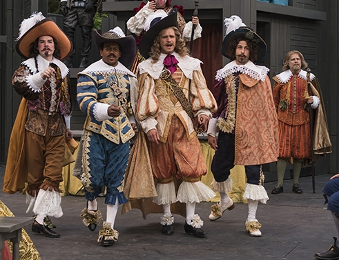 Marcus Truschinski takes centerstage with other elegantly dressed Marquises in Cyrano de Bergerac at American Players Theatre.