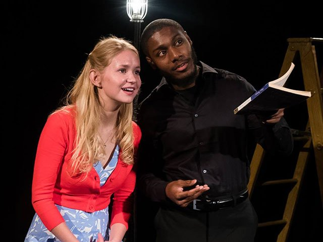 Emma Bahnson (Emily) and Denzel Taylor (The Stage Manager) in the UW Theatre Department's production of  Our Town .