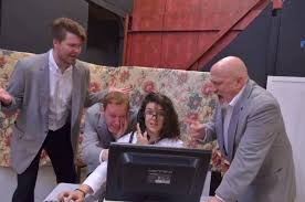 The cast of  Temps! The Musical!  trying to figure out how to get a report out of a broken computer.