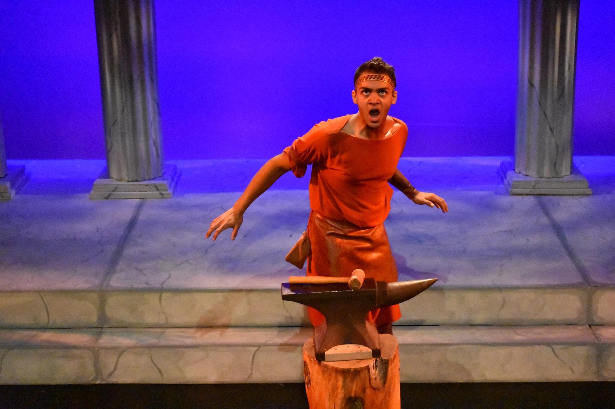 Caleb Mathura at his forge as Hephaestus.