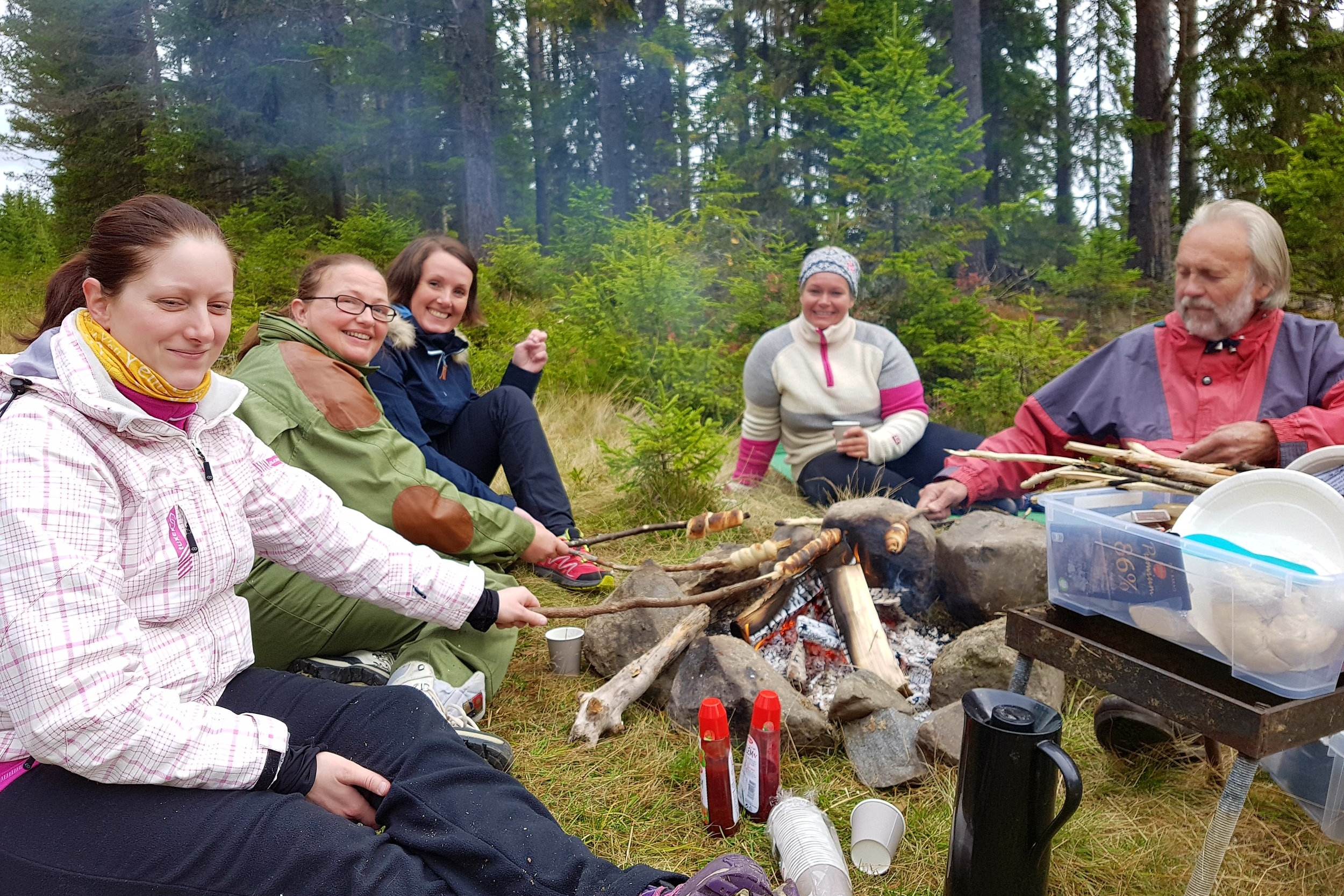 Coffee and bread twists around the fire after tour