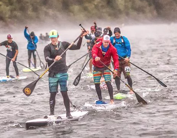 Steven Barry (lead paddler wearing black and green) at Chattajack 31. Steven will be hosting a SUP paddling clinic to help you improve your stroke efficiency and speed.