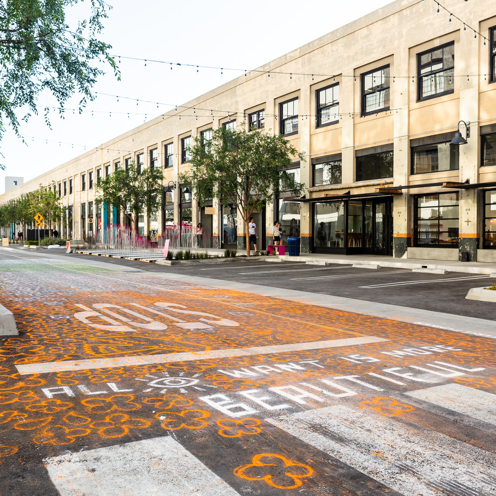 """the ground remembers by Eric Junker   Described as """"an impermanent impression of primordial remembering in real time,"""" artist Eric Junker covered the streets with vibrant chalk for this installation."""