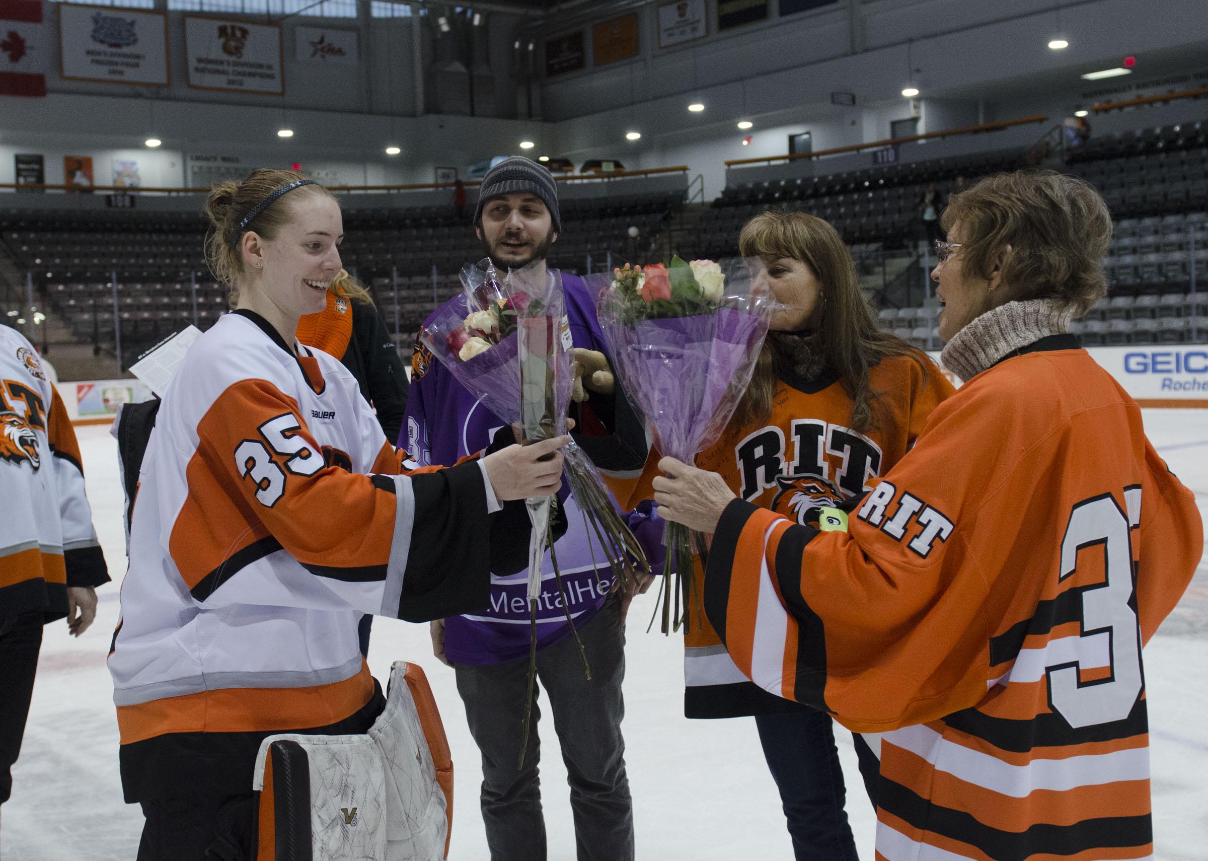 Jetta Rackleff (35) receives flowers from friends and family on senior day.