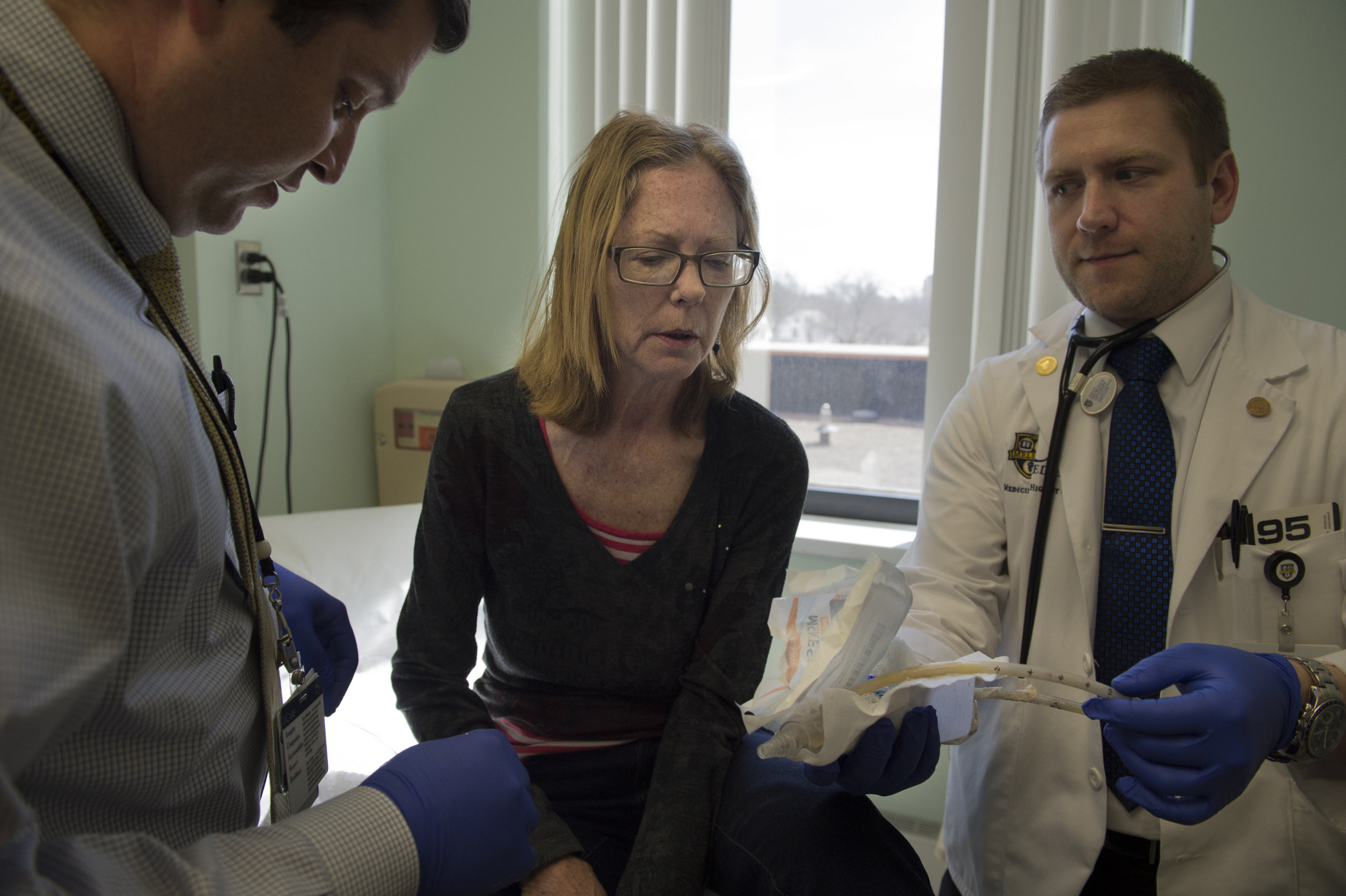 Carol is shown the chest tube that was inserted for lung drainage after a biopsy by her surgeon after it is removed.