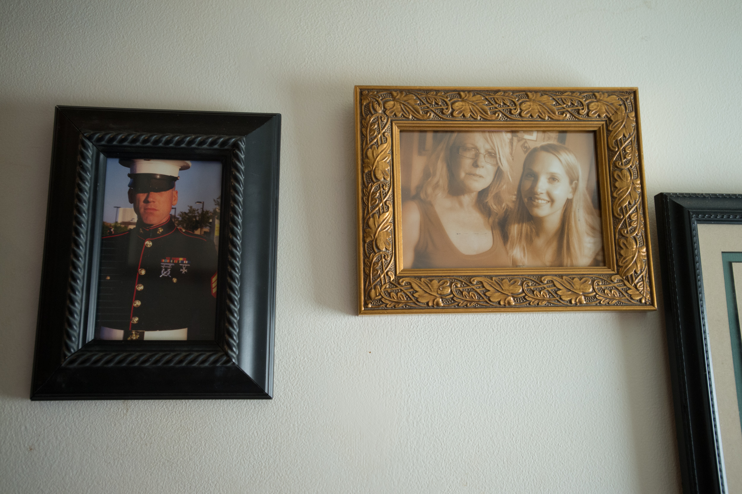 Photos of Carol's two children, Gabe Sloan and Margaret Elizabeth are among many wall hangings at Carol's house.