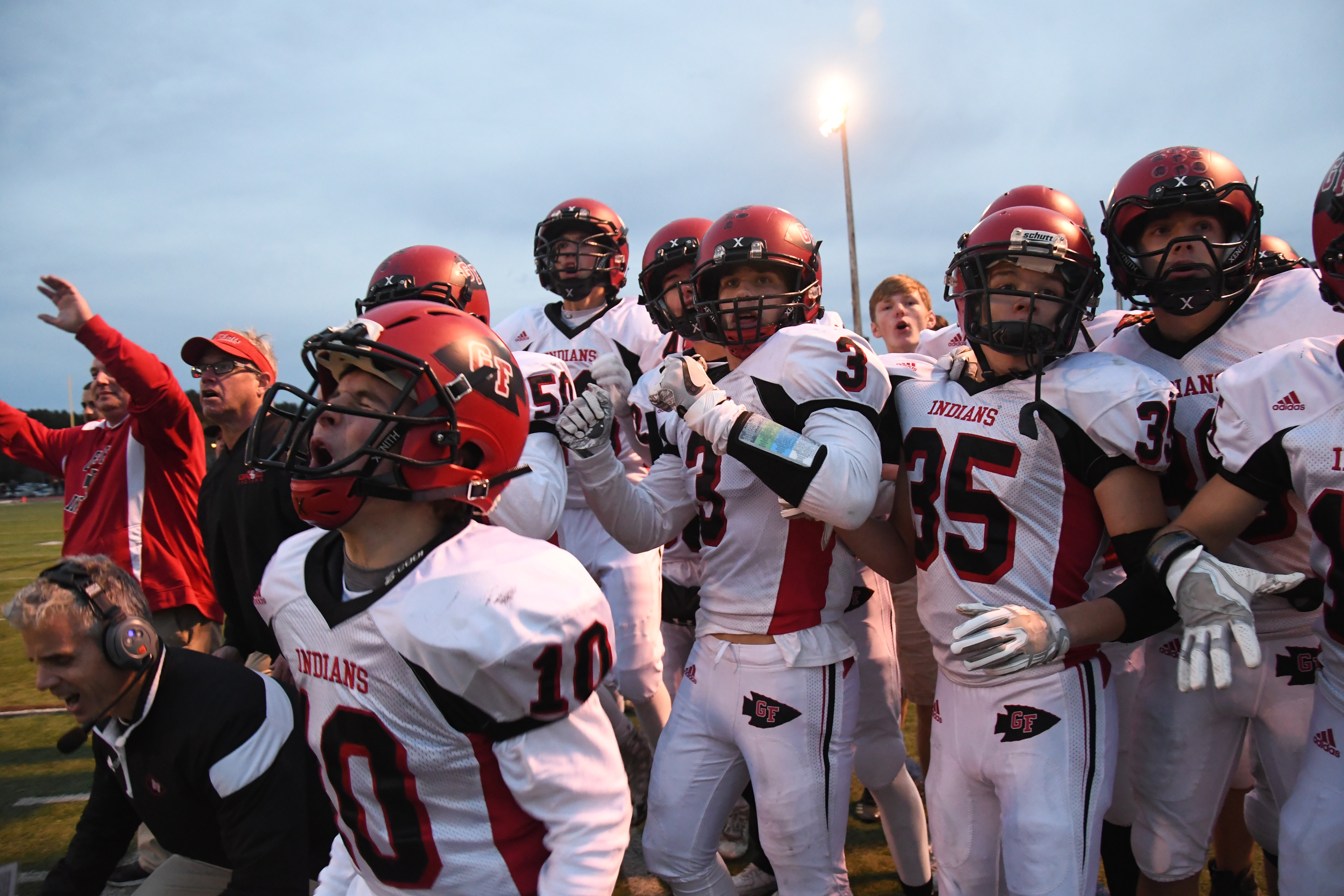 Glens Falls football players cheer after a first down is made in the fourth quarter during the Class B Super Bowl against Schuylerville on Saturday, Nov. 4, 2017 in Clifton Park, N.Y.. Glens Falls beat Schuylerville 40-37 after making a field goal in overtime.
