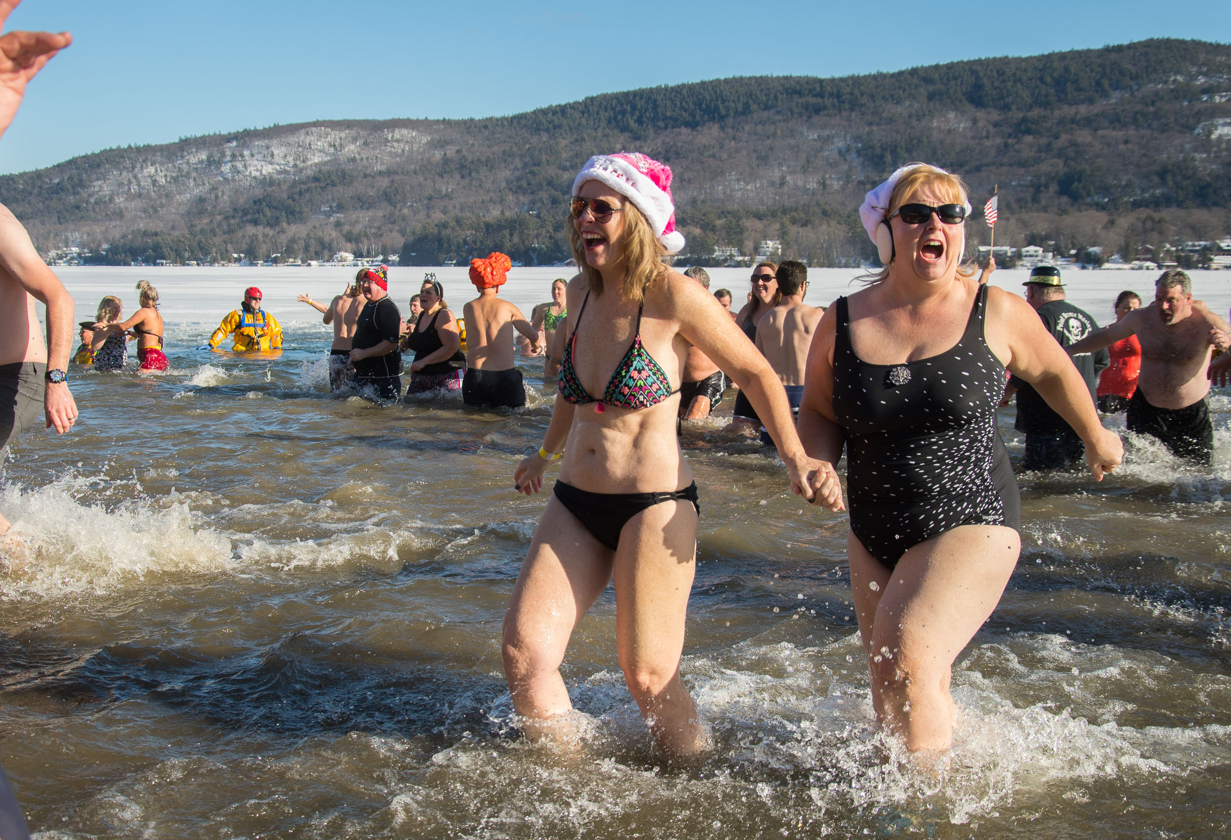 Two women dash out of the waters of Lake George during the Lake George Annual Polar Plunge on Monday, New Years Day of 2018, in Lake George, N.Y. Temperatures dropped to a frigid 4-degrees for the event.