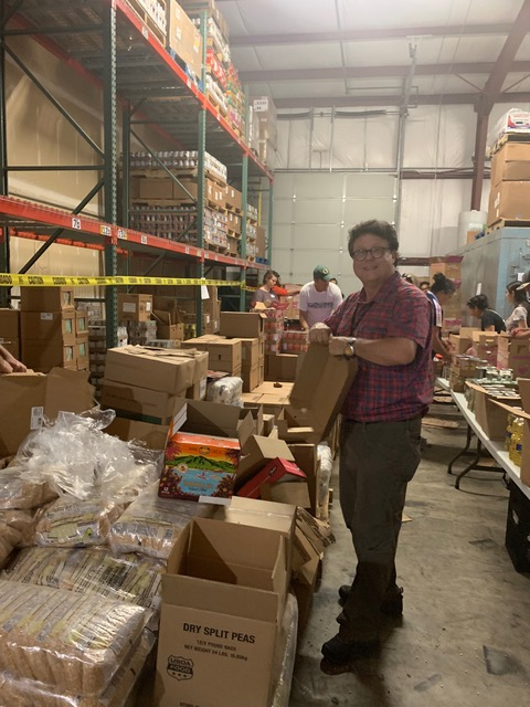 Bob Gobbo, MD at the Cherry Harvest Migrant Farmworker Food Drive packing event, Wednesday, June 12.