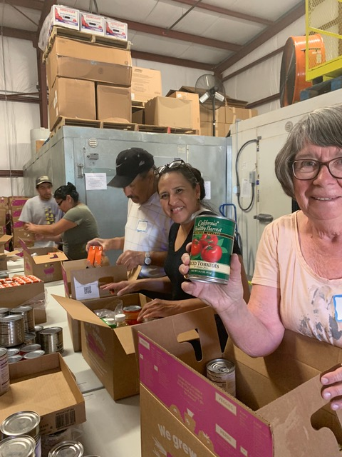Packing boxes for migrant farmworker food drive (right to left): Carol Hayes, Carmen Barrera, Joel Pelayo, Liliana Lachino, and Mariano Sendejas