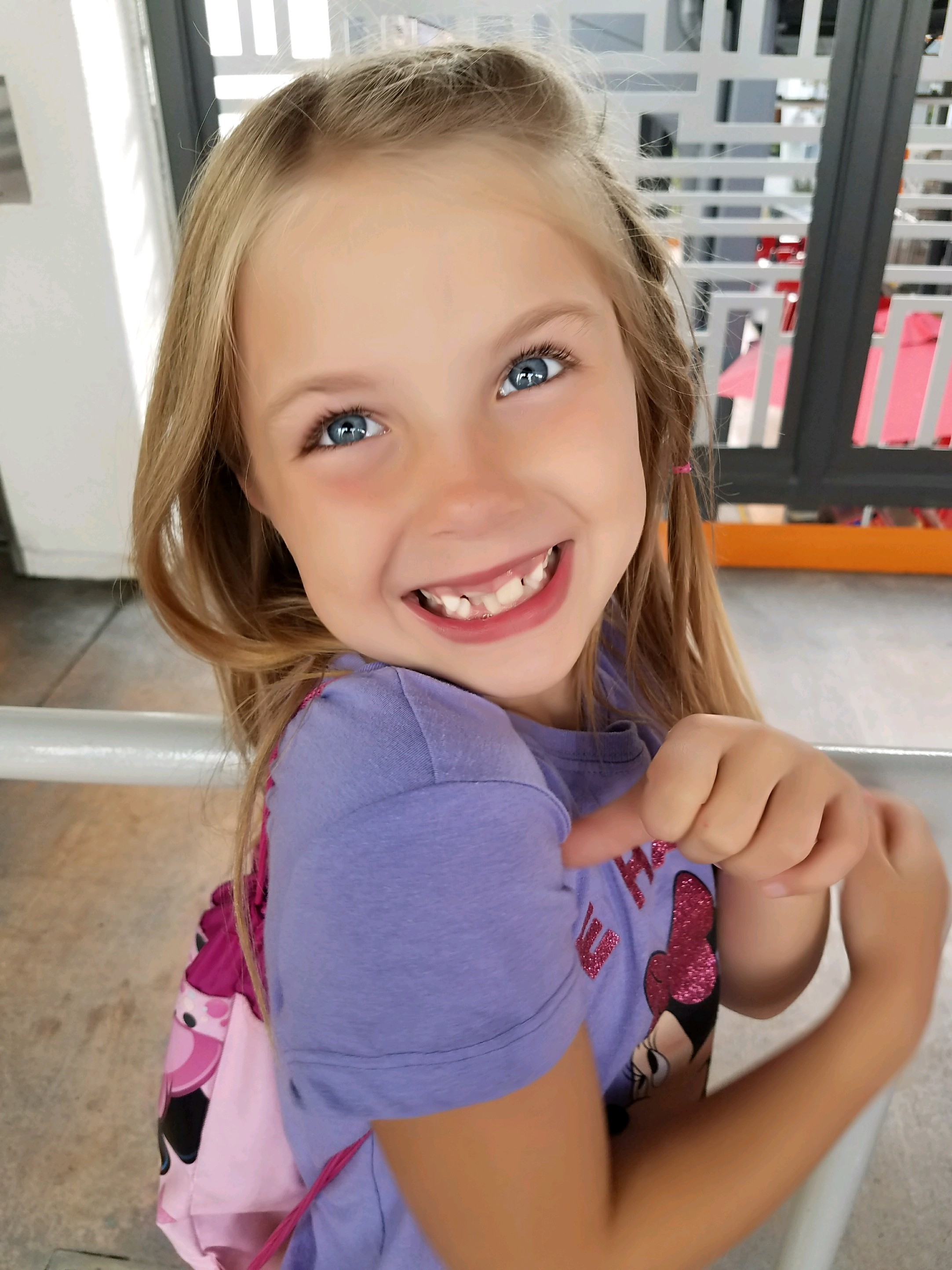 Josie Piatt shows off her grin in spite of worries over possibly losing a permanent tooth.