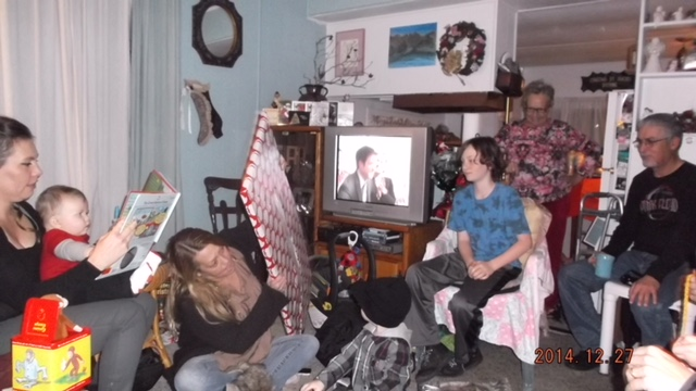 Zealand with his extended family, including grandma Judy who stands behind him, in her Journey's End Mobile Park home on Christmas 2014.