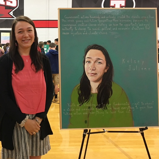 """June 2018:  Kelsey and her    Americans Who Tell The Truth    portrait by Robert Shetterly, which was unveiled on June 4, 2018 at the 4th annual Samantha Smith Challenge at Thomas College in Walterville, Maine.""""Government actions knowingly and willingly created the climate crisis. From this crisis young and future generations face increasing dangers. As courageous, creative change-makers we have the opportunity and moral authority to change the social, political and economic structures that cause injustice and climate chaos. Youth are standing up for our fundamental right to inherit a stable and survivable planet. We have everything to gain from taking action and everything to lose from not."""""""