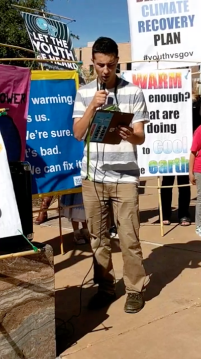 Omar with the microphone as he makes his statement at the October 29 rally in Albuquerque, New Mexico.
