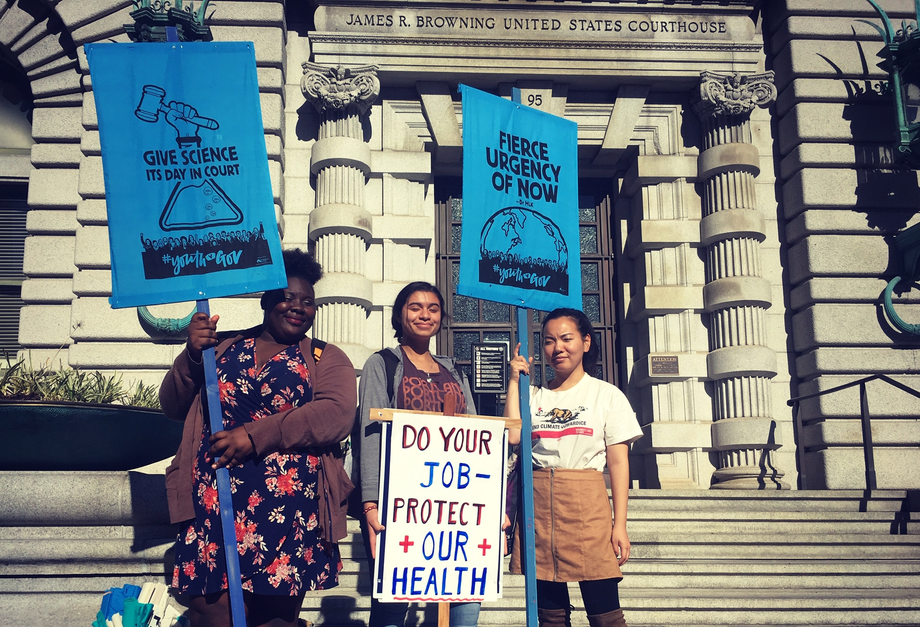 Linda Scruggs (left) stands alongside participants at the San Francisco rally to support the climate kids.