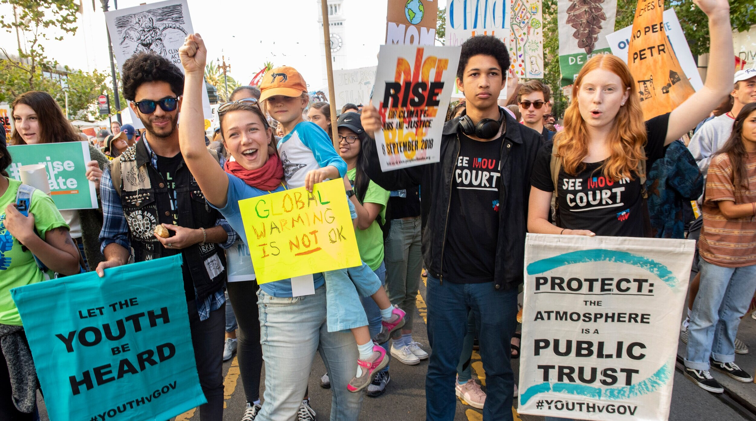 Juliana v. US  plaintiffs Kiran, Kelsey, Aji, and Tia at a climate march in San Francisco last year.