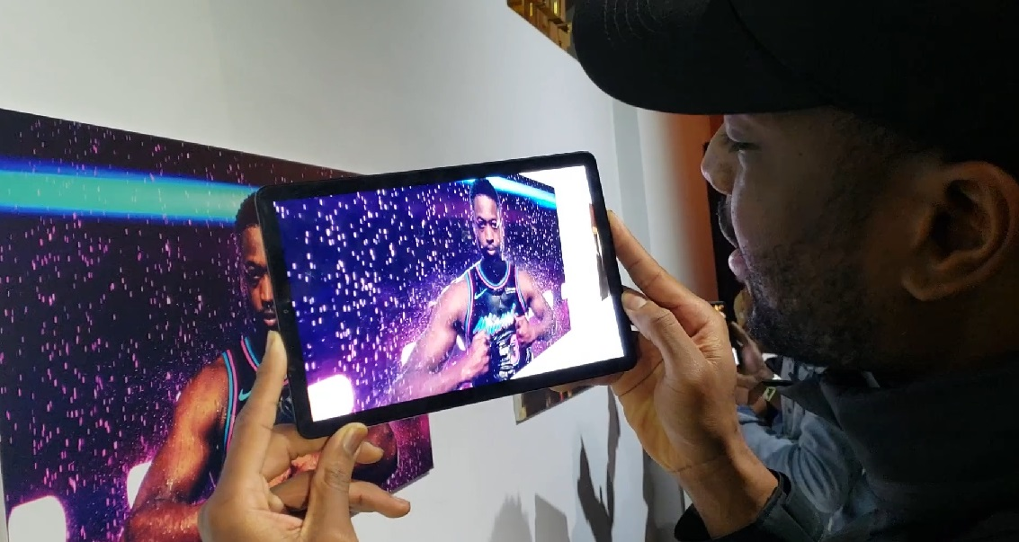 Dwyane Wade looking at the AR experience we created for his event.