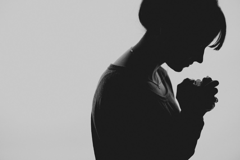 silhouette woman praying.jpg