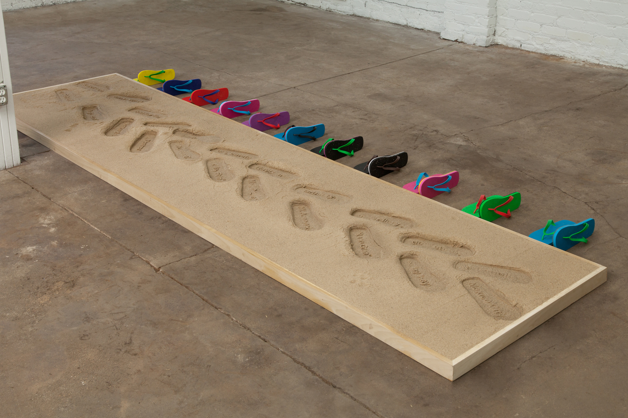 """Lean In To Walking: Customizable Resume Sand Impression Sandals   2""""x 144""""x 48""""  sand in poplar frame with cnc'd vulcanized rubber  2017"""