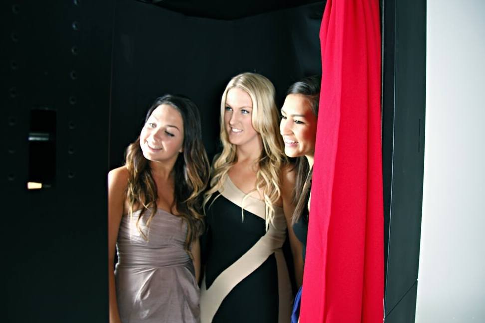 Classic Booth - The classic booth is an enclosed, portable photo booth perfect for private photos. A great addition to any event, guests will come away with a little something to remember the night.