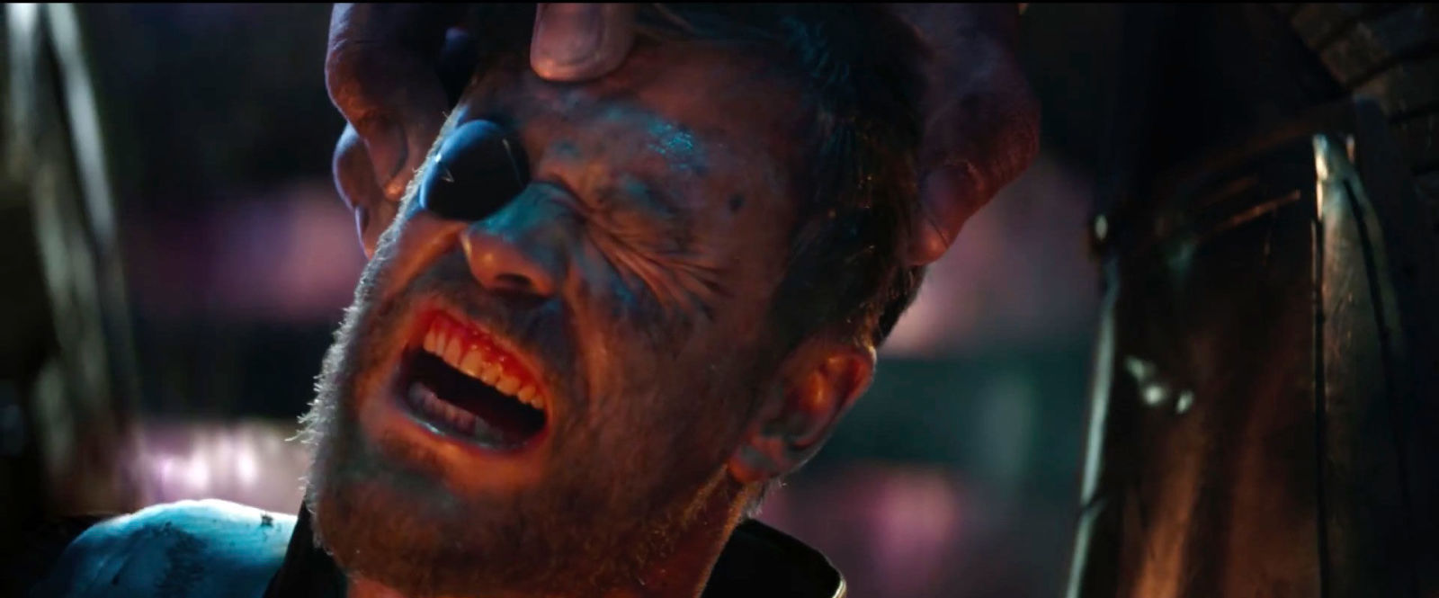 Thor's head being held by Thanos