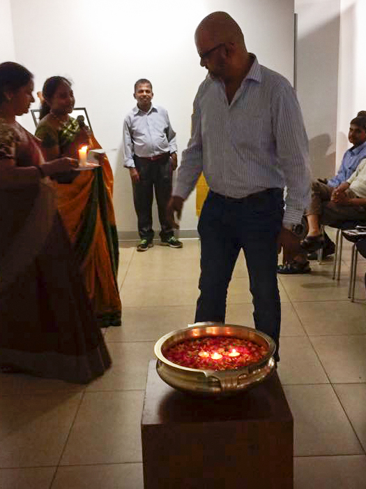 Arvind Chenji floating a candle.
