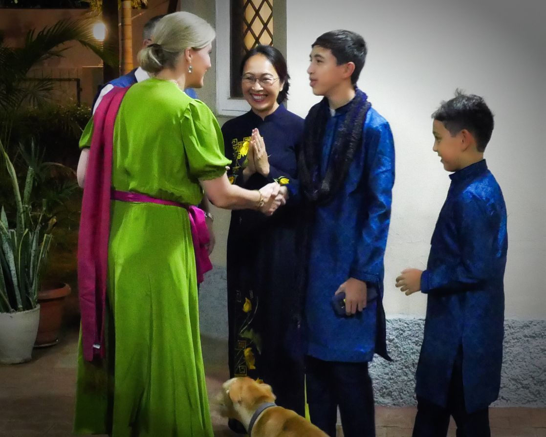 Andrew, Van, Alex and Arran Fleming, together with their rescue dog Muni, welcome Sophie, Countess of Wessex to their home for the reception.